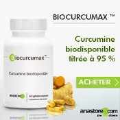Boîte de gélules de curcuma titré à 95 % en curcumine biodisponible. Racines et gélules de curcuma à côté de la boîte.