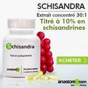Complément alimentaire à base de schisandra : boîte, gélules et baies rouges.